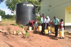 The Water Project: Kalisasi Secondary School -  Students Lined Up At Small Rainwater Tank
