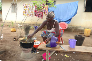 The Water Project: Lungi, Suctarr, #3 Lovell Lane -  Woman Cooking