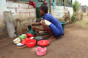 The Water Project: Lungi, Suctarr, #3 Lovell Lane -  Woman Clean Dishes