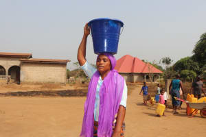 The Water Project: Lungi, New London, Saint Dominic's Catholic Church -  Woman Carrying Water