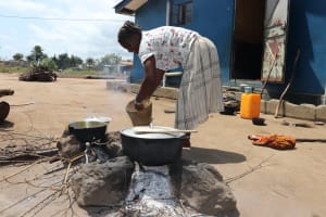 The Water Project: Lungi, Suctarr, #47 Kamara Street -  Woman Cooking