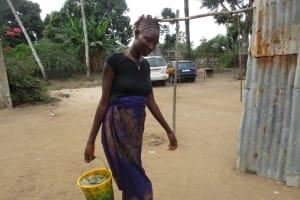 The Water Project: Lungi, Rotifunk, 22 Kasongha Road -  Community Member Carrying Water