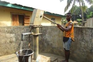 The Water Project: Lungi, Rotifunk, 22 Kasongha Road -  Member Collecting Water