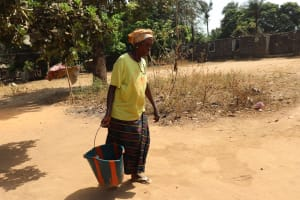 The Water Project: Lungi, Suctarr, #1 Kabbia Lane -  Old Woman Carrying Water