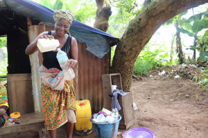 The Water Project: Lungi, Suctarr, #1 Kabbia Lane -  Woman Selling Palm Wine