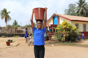 The Water Project: Lungi, Tintafor, St. Augustine Senior Secondary School -  Student Carrying Water