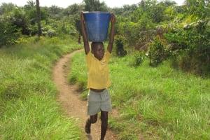 The Water Project: Lokomasama, Conteya Village -  Carrying Water