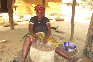 The Water Project: Lokomasama, Conteya Village -  Breaking Palm Kernel Nuts