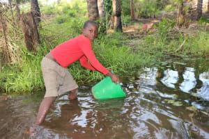 The Water Project: Lokomasama, Rotain Village -  Small Boy Collecting Water