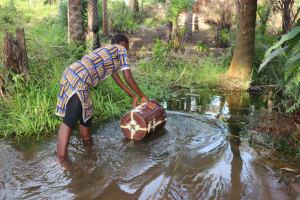 The Water Project: Lokomasama, Rotain Village -  Girl Collecting Water