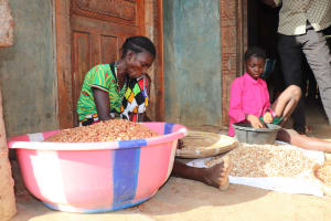 The Water Project: Lokomasama, Rotain Village -  Woman And Child Processing Ground Nut