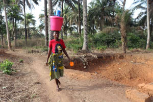The Water Project: Lokomasama, Rotain Village -  Woman Carrying Water