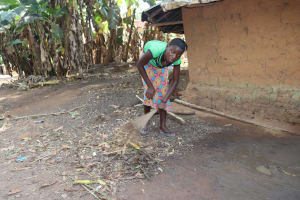 The Water Project: Lokomasama, Rotain Village -  Woman Sweeping