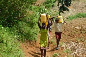 The Water Project: Khaunga A Community, Murutu Spring -  Taking Water Home From Murutu Spring
