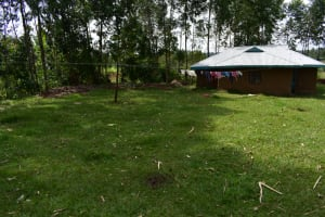 The Water Project: Mukhuyu Community, Namukuru Spring -  Home Compound With A Clothesline
