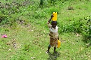 The Water Project: Mukhuyu Community, Namukuru Spring -  Taking Water Home From Namukuru Spring