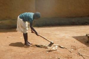 The Water Project: Musango Community, Wambani Spring -  Getting Some Splitting Firewood To Start Preparing Lunch