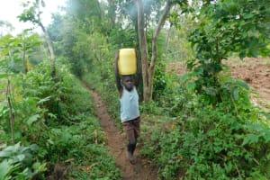 The Water Project: Musango Community, Wambani Spring -  Taking Water Home From Wambani Spring