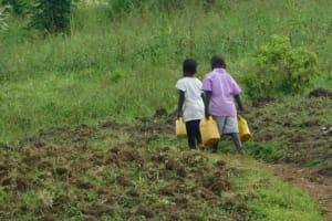 The Water Project: Maraba Community, Nambwaya Spring -  Carrying Water From Nambwaya Spring