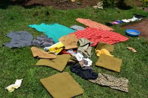 The Water Project: Bukalama Community, Wanzetse Spring -  Airing Laundry To Dry