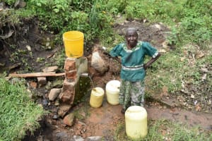 The Water Project: Bukalama Community, Wanzetse Spring -  Collecting Water From Wanzetse Spring