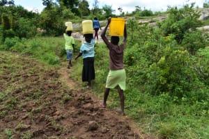 The Water Project: Bukalama Community, Wanzetse Spring -  Taking Water Home From Wanzetse Spring
