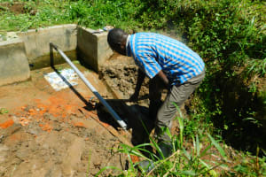 The Water Project: Ikonyero Community, Jesse Spring -  Water Diverted With Pvc Pipe