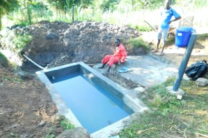 The Water Project: Ikonyero Community, Jesse Spring -  Water Filled Reservoir Tank