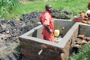 The Water Project: Eshiakhulo Community, Asman Sumba Spring -  Artisan Joseph Working Inside The Tank