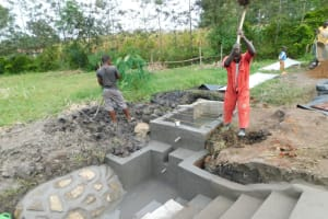 The Water Project: Eshiakhulo Community, Asman Sumba Spring -  Steel Bars Laid Over Reservoir Tank