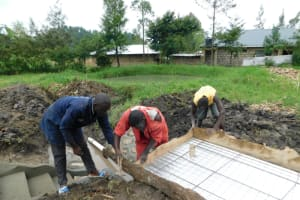 The Water Project: Eshiakhulo Community, Asman Sumba Spring -  Aligning Iron Sheet And Wiremesh Cover Before Pouring Concrete