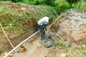 The Water Project: Ikonyero Community, Jesse Spring -  Excavation Of Drainage Channel