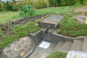 The Water Project: Eshiakhulo Community, Asman Sumba Spring -  Complete Rservoir Tank With Water Flowing