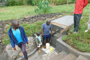 The Water Project: Eshiakhulo Community, Asman Sumba Spring -  Water Users Fetching Water