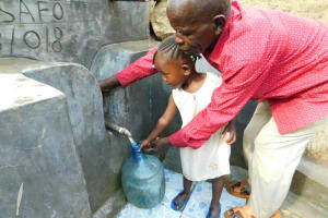 The Water Project: Ikonyero Community, Jesse Spring -  Showing How To Turn On The Valve