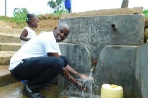The Water Project: Ikonyero Community, Jesse Spring -  Field Officer Jonathan Mutai Celebrates The New Reservoir Tank