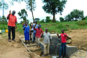 The Water Project: Ikonyero Community, Jesse Spring -  Community Celebrating The Reservoir Tank