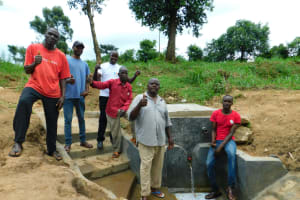 The Water Project: Ikonyero Community, Jesse Spring -  Thumbs Up For Improved Water Access