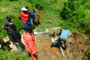 The Water Project: Ikonyero Community, Jesse Spring -  Rub Wall Clearance