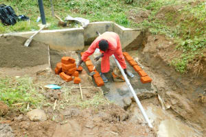 The Water Project: Ikonyero Community, Jesse Spring -  Brick Setting For Reservoir Tank