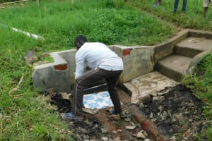 The Water Project: Eshiakhulo Community, Asman Sumba Spring -  Removing The Stone Pitching For
