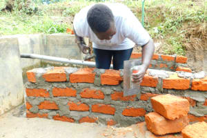The Water Project: Ikonyero Community, Jesse Spring -  Wall Construction