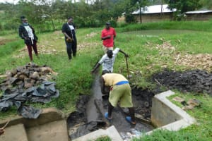 The Water Project: Eshiakhulo Community, Asman Sumba Spring -  Clearing The Ground For Construction Of Reservoir