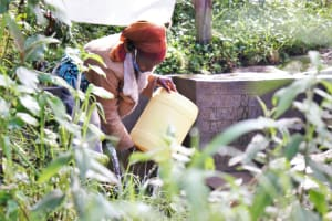 The Water Project: Bukhaywa Community, Ashikhanga Spring -  Cleaning Her Container Before Fetching Water