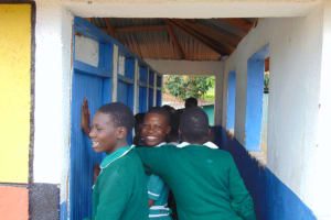 The Water Project: Mwembe Primary School -  Girls Lining Up At The Latrines