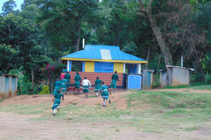 The Water Project: Mwembe Primary School -  Girls Running To Their Toilets