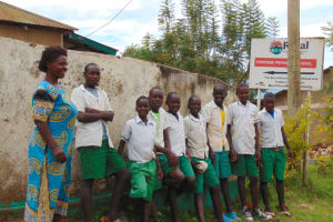 The Water Project: Mwembe Primary School -  Students And Teacher At The School Gate