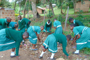 The Water Project: Mwembe Primary School -  Students Cleaning The School Compound