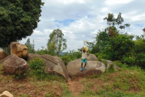 The Water Project: Mwembe Primary School -  Carrying Water To School