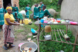 The Water Project: Mwembe Primary School -  School Cook At The Dishrack